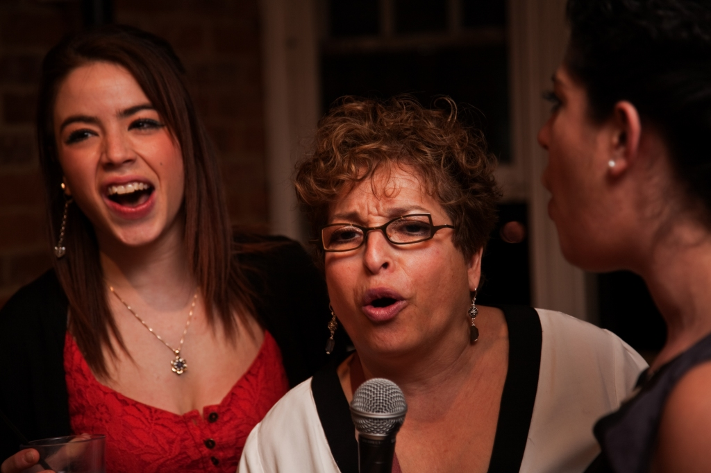 My lovely wife getting into the karaoke with Kailey and Joanna